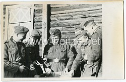 Foto, Angehöriger der Wehrmacht mit Ärmelband