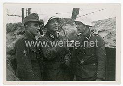 Waffen-SS Foto, SS-Unterscharführer mit Wintertarnlackierung auf dem Stahlhelm