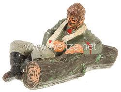 Elastolin - Heer Verwundeter am Baumstamm liegend