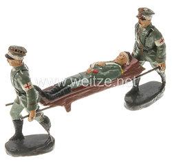 Elastolin - Heer 2 Sanitätssoldaten mit Verwundeten auf Bahre marschierend