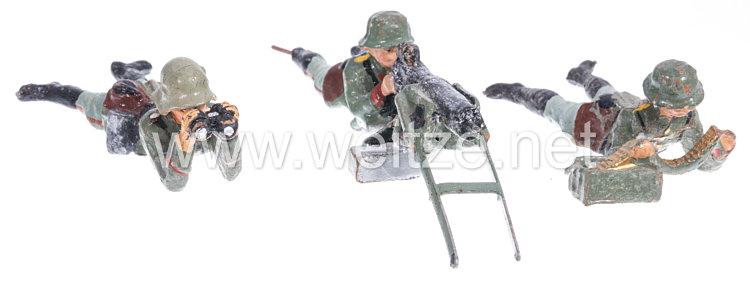 Elastolin - Heer MG Schütze liegend am SMG mit Schütze Munition zuführend und Gewehrführer mit Fernglas