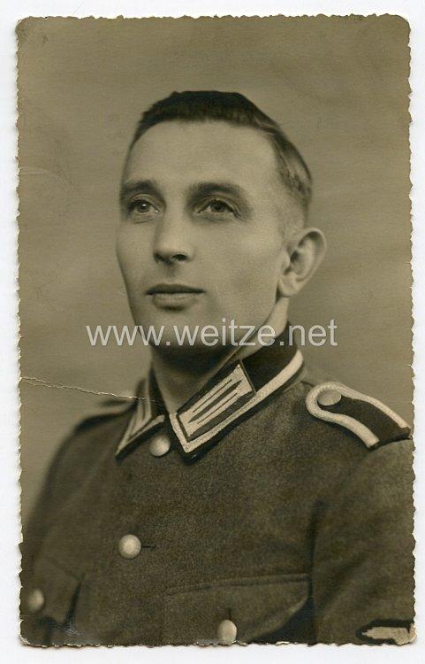 SS - Polizeidivision Portraitfoto, SS-Unterscharführer mit Feldbluse
