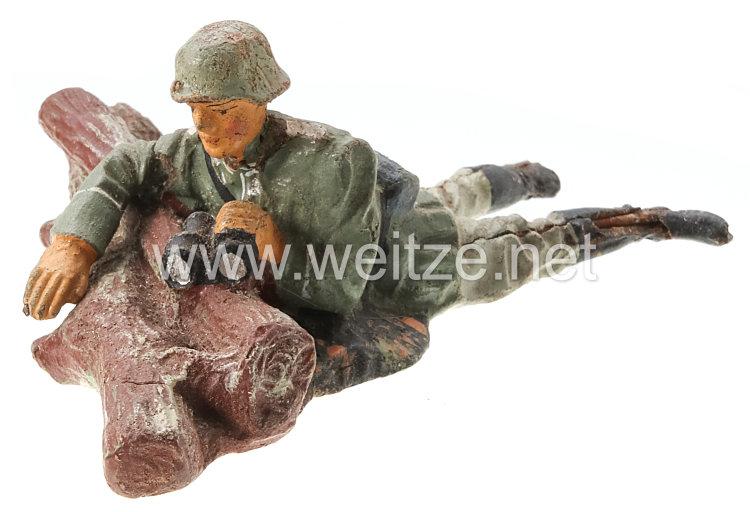 Elastolin - Heer Gruppenführer auf Baumstamm mit Fernglas liegend